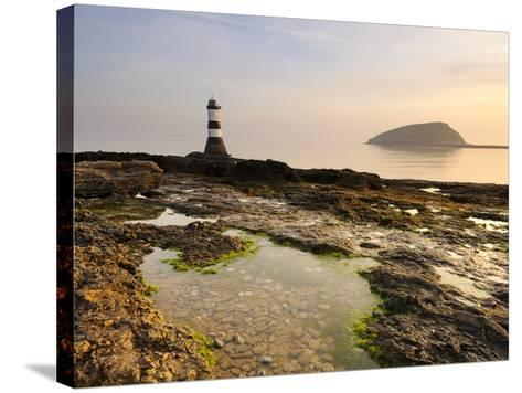 Dawn at Penmon Lighthouse, Penmon Point, Anglesey, North Wales, Wales, United Kingdom, Europe-Chris Hepburn-Stretched Canvas Print