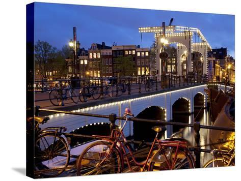 Magere Brug (Skinny Bridge) at Dusk, Amsterdam, Holland, Europe-Frank Fell-Stretched Canvas Print