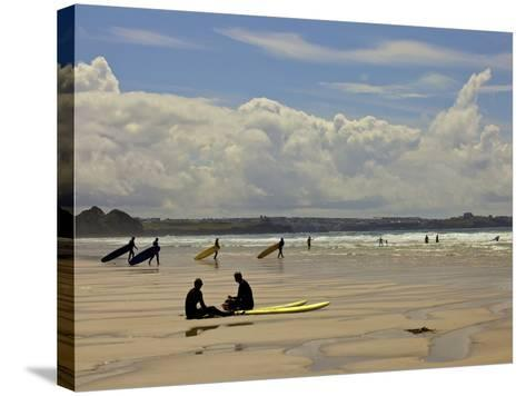 Surfers with Boards on Perranporth Beach, Cornwall, England-Simon Montgomery-Stretched Canvas Print