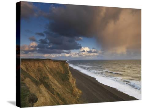 A Rain Cloud Approaches the Cliffs at Weybourne, Norfolk, England-Jon Gibbs-Stretched Canvas Print