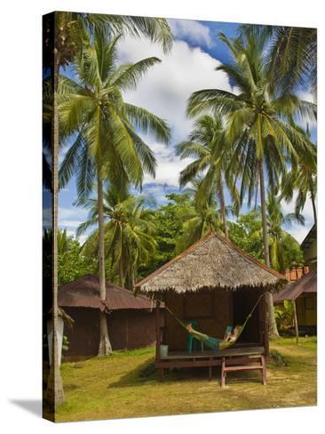 Tourist Relaxing in a Hammock on a Bamboo Beach Hut on the Thai Island of Koh Lanta, South Thailand-Matthew Williams-Ellis-Stretched Canvas Print