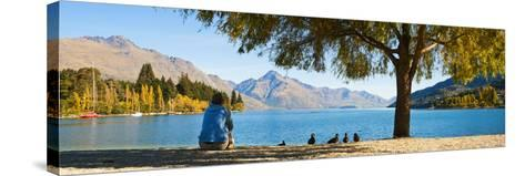 Panorama of Tourist Relaxing by Lake Wakatipu in Autumn at Queenstown, Otago, New Zealand-Matthew Williams-Ellis-Stretched Canvas Print