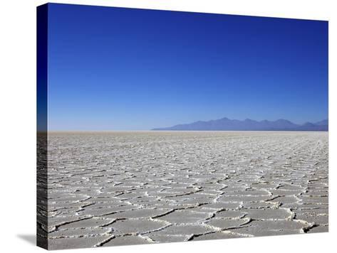 Salt Deposits in Salar de Uyuni Salt Flat and Andes Mountains in Distance in South-Western Bolivia-Simon Montgomery-Stretched Canvas Print