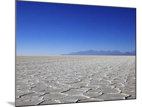 Salt Deposits in Salar de Uyuni Salt Flat and Andes Mountains in Distance in South-Western Bolivia-Simon Montgomery-Mounted Photographic Print