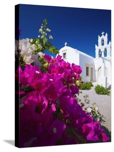 Greek Church and Flowers, Santorini, Cyclades, Greek Islands, Greece, Europe-Sakis Papadopoulos-Stretched Canvas Print