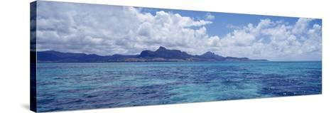 Ocean with Mountains in the Background, Mauritius--Stretched Canvas Print
