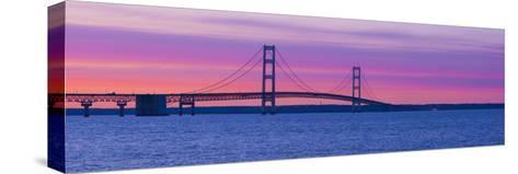 Silhouette of a Suspension Bridge at Sunset, Mackinac Bridge, Michigan, USA--Stretched Canvas Print
