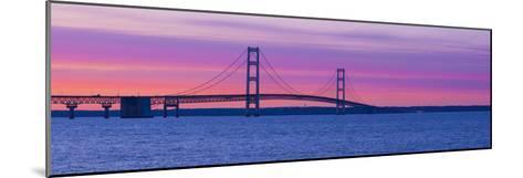 Silhouette of a Suspension Bridge at Sunset, Mackinac Bridge, Michigan, USA--Mounted Photographic Print
