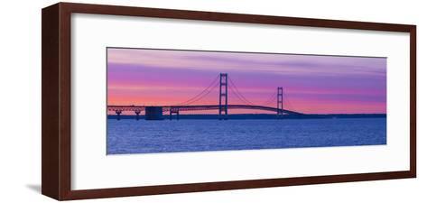 Silhouette of a Suspension Bridge at Sunset, Mackinac Bridge, Michigan, USA--Framed Art Print