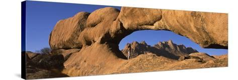 Mountains Viewed Through a Natural Arch with a Mother Holding Her Baby, Spitzkoppe, Namib Desert...--Stretched Canvas Print