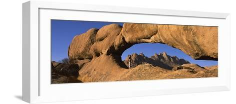 Mountains Viewed Through a Natural Arch with a Mother Holding Her Baby, Spitzkoppe, Namib Desert...--Framed Art Print
