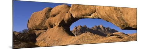 Mountains Viewed Through a Natural Arch with a Mother Holding Her Baby, Spitzkoppe, Namib Desert...--Mounted Photographic Print