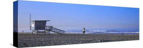 Rear View of a Surfer on the Beach, Santa Monica, Los Angeles County, California, USA--Stretched Canvas Print