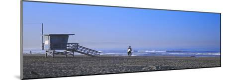 Rear View of a Surfer on the Beach, Santa Monica, Los Angeles County, California, USA--Mounted Photographic Print