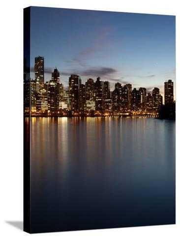Downtown Skylines Lit Up at the Waterfront, Coal Harbor, Lost Lagoon, Vancouver, British Columbi...--Stretched Canvas Print