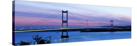 Bridge across a River at Dusk, Severn Bridge, Aust, Gloucestershire, England--Stretched Canvas Print