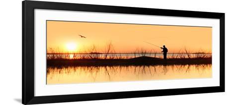 Silhouette of a Man Fishing--Framed Art Print