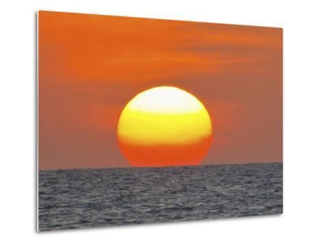 Close Up of the Sun Setting over the Gulf of Mexico-Mike Theiss-Metal Print