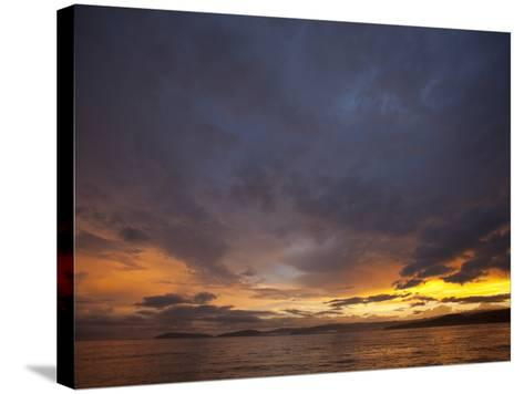 Sunset over the Pacific Ocean by Osa Peninsula-Michael Melford-Stretched Canvas Print