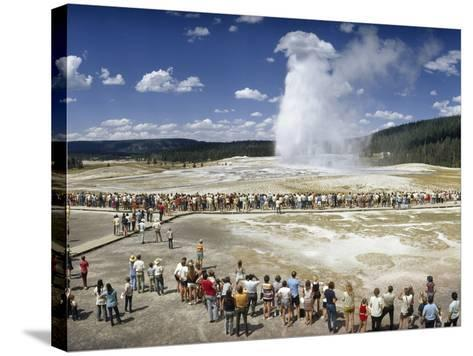 Crowds of Tourists Flock around the Erupting Old Faithful Geyser-Jonathan Blair-Stretched Canvas Print