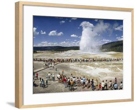 Crowds of Tourists Flock around the Erupting Old Faithful Geyser-Jonathan Blair-Framed Art Print