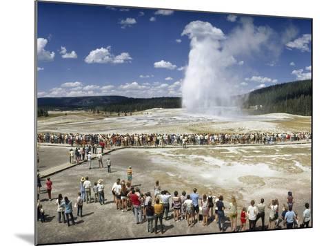 Crowds of Tourists Flock around the Erupting Old Faithful Geyser-Jonathan Blair-Mounted Photographic Print