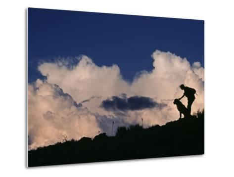 A Hiker and Her Dog Below Thunderheads in Arid Volcanic Tablelands-Gordon Wiltsie-Metal Print