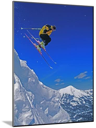 A Skier Jumps a Cornice at Exclusive Yellowstone Club Ski Area, Montana-Gordon Wiltsie-Mounted Photographic Print