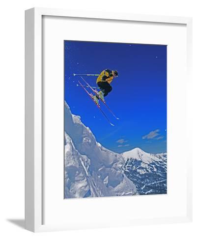 A Skier Jumps a Cornice at Exclusive Yellowstone Club Ski Area, Montana-Gordon Wiltsie-Framed Art Print