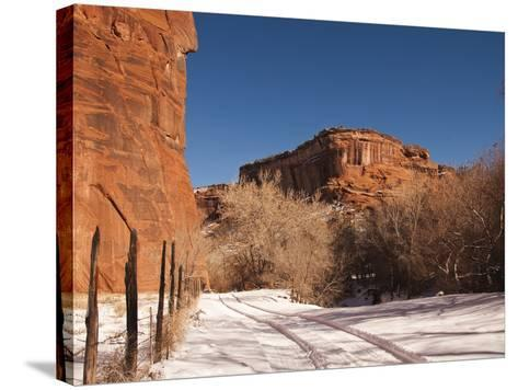 Tire Tracks in the Snow at the Canyon De Chelly Cliffs-James Forte-Stretched Canvas Print
