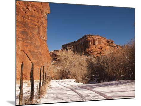 Tire Tracks in the Snow at the Canyon De Chelly Cliffs-James Forte-Mounted Photographic Print