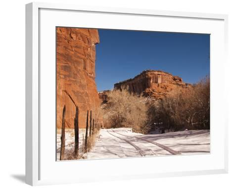 Tire Tracks in the Snow at the Canyon De Chelly Cliffs-James Forte-Framed Art Print
