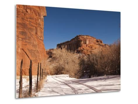 Tire Tracks in the Snow at the Canyon De Chelly Cliffs-James Forte-Metal Print
