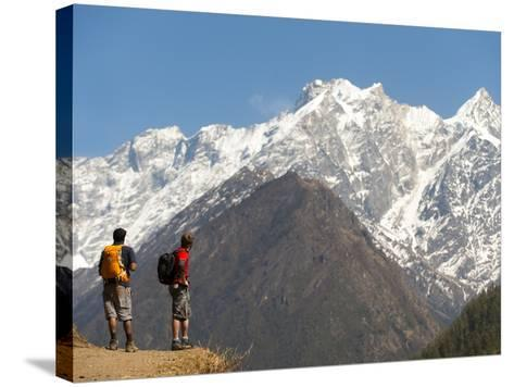 Trekkers in the Tsum Valley Admire Views of the Ganesh Himal Mountains-Alex Treadway-Stretched Canvas Print