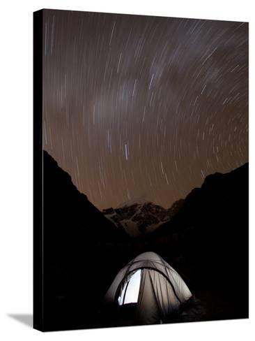A Long Exposure Reveals the Earth Rotation Above Tents at Jhangothang-Alex Treadway-Stretched Canvas Print