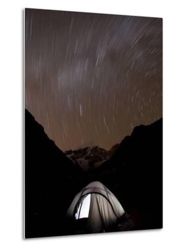 A Long Exposure Reveals the Earth Rotation Above Tents at Jhangothang-Alex Treadway-Metal Print