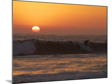 Surfer Riding a Wave at Sunset over the Pacific Ocean-Tim Laman-Mounted Photographic Print