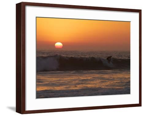 Surfer Riding a Wave at Sunset over the Pacific Ocean-Tim Laman-Framed Art Print