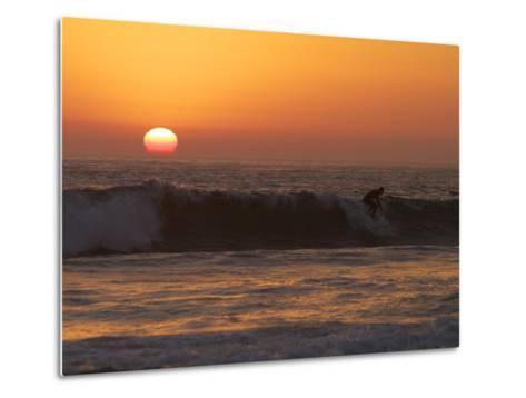 Surfer Riding a Wave at Sunset over the Pacific Ocean-Tim Laman-Metal Print
