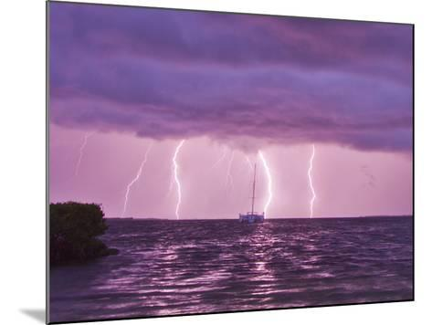 Lightning Bolts Striking the Ocean, and Almost Hitting a Sailboat-Mike Theiss-Mounted Photographic Print
