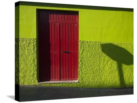 A Green Building with a Red Door in Merida-Tino Soriano-Stretched Canvas Print