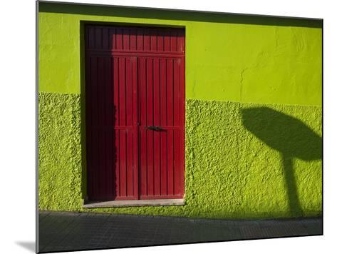 A Green Building with a Red Door in Merida-Tino Soriano-Mounted Photographic Print