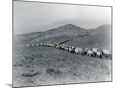 Wagon Train - Oregon Trail Wagon Train Reenactment, 1935-Ashael Curtis-Mounted Giclee Print