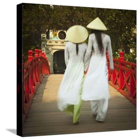 Girls Wearing Ao Dai Dress, Huc Bridge, Hoan Kiem Lake, Hanoi, Vietnam-Jon Arnold-Stretched Canvas Print