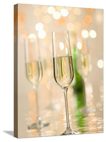 Glasses of Sparkling Wine with Twinkling Lights-Brigitte Protzel-Stretched Canvas Print