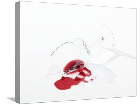 Broken Wine Glass with Spilt Red Wine--Stretched Canvas Print