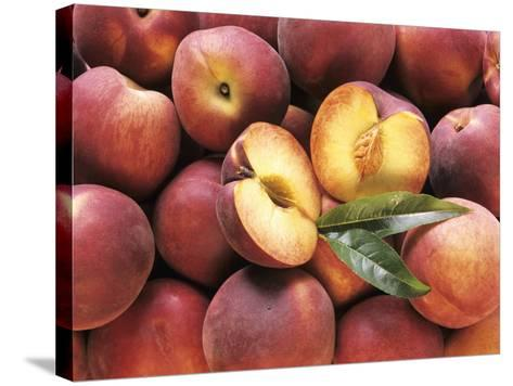 Many Whole Peaches with One Halved--Stretched Canvas Print