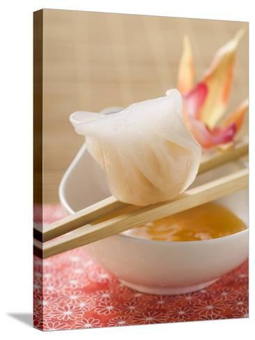 Dim Sum on Chopsticks over Dip (Asia)--Stretched Canvas Print