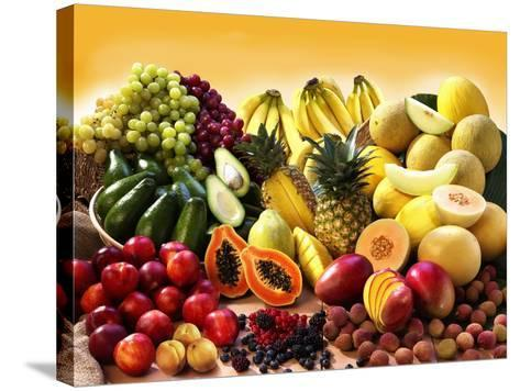 Display of Exotic Fruit with Stone Fruits, Berries and Avocados--Stretched Canvas Print