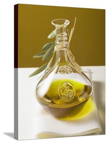 Olive Oil in Carafe with Olive Branch--Stretched Canvas Print